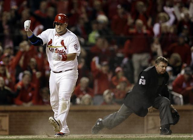 St. Louis Cardinals' Matt Adams celebrates after scoring during the fifth inning of Game 6 of the National League baseball championship series against the Los Angeles Dodgers Friday, Oct. 18, 2013, in St. Louis. (AP Photo/Jeff Roberson)