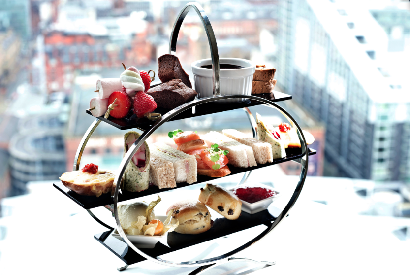 "<p>Head up to the 23rd floor for your sugar hit in Manchester at Cloud 23 in the Hilton Deansgate Hotel. The traditional afternoon tea has all your favourites - think scones, finger sandwiches and mini cakes - and the views aren't half bad either. The tea costs £23 per person. </p><p><b><a rel=""nofollow noopener"" href=""http://www3.hilton.com/en/hotels/united-kingdom/hilton-manchester-deansgate-MANDGHI/dining/index.html"" target=""_blank"" data-ylk=""slk:Hilton.com"" class=""link rapid-noclick-resp"">Hilton.com</a></b></p>"