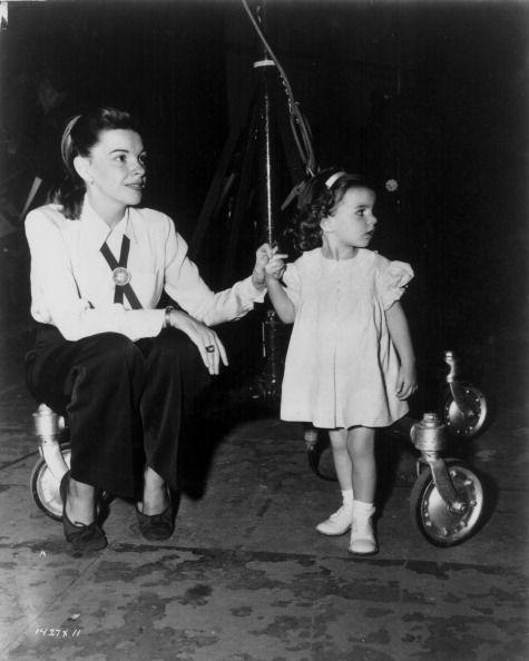<p>A 2-year-old Liza Minnelli visits her mother, Judy Garland, on the set of <em>Words and Music </em>in 1948. </p>