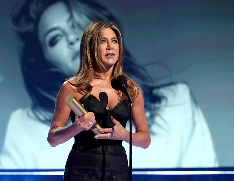 SANTA MONICA, CALIFORNIA - NOVEMBER 10: 2019 E! PEOPLE'S CHOICE AWARDS -- Pictured: Jennifer Aniston receives the People's Icon award on stage during the 2019 E! People's Choice Awards held at the Barker Hangar on November 10, 2019 -- NUP_188993 (Photo by: Christopher Polk/E! Entertainment/NBCU Photo Bank)