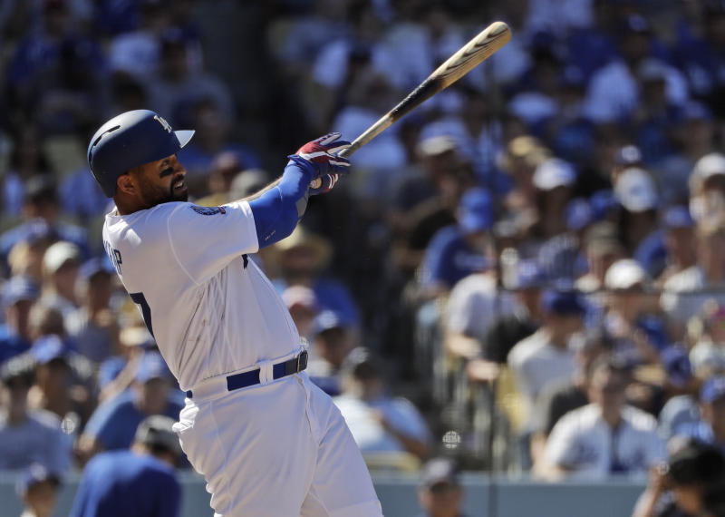 Los Angeles Dodgers' Matt Kemp drives in two runs with a single against the San Diego Padres during the fourth inning of a baseball game Sunday, Sept. 23, 2018, in Los Angeles. (AP Photo/Marcio Jose Sanchez)