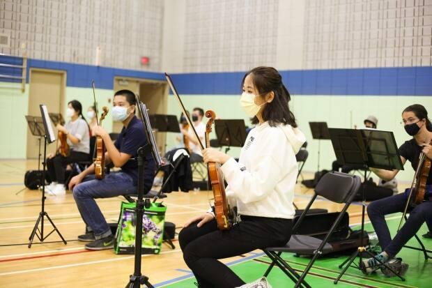 Members of the Mount Royal Youth Orchestra have been split into four groups because they cannot practise together inside under the current health restrictions. (Submitted by Jean MacRae - image credit)