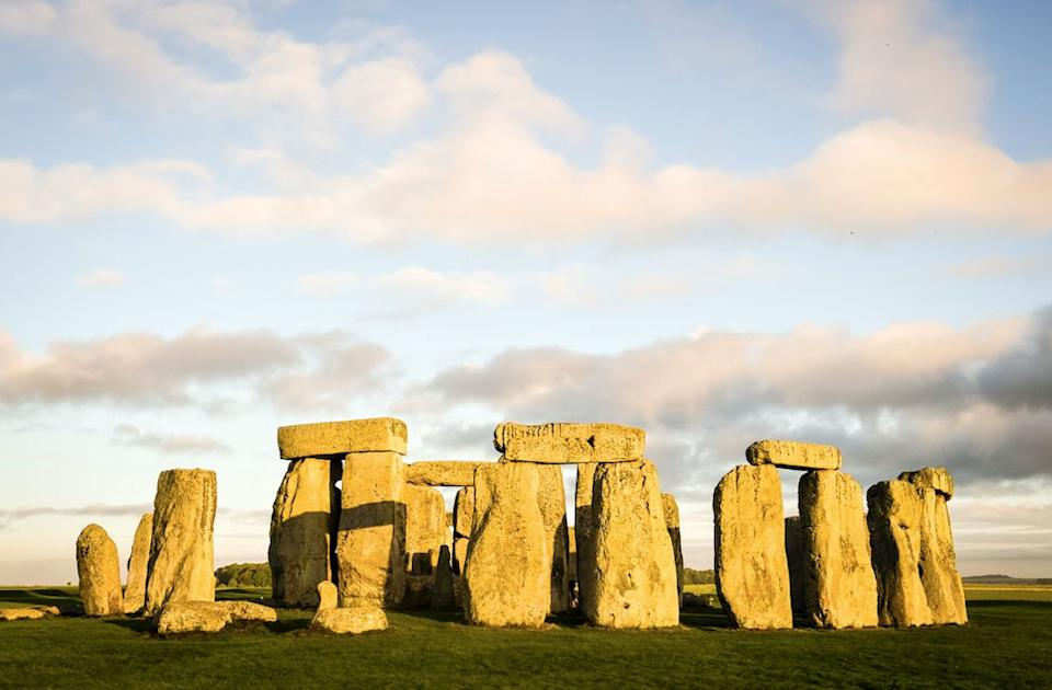 A missing piece of one of the huge sarsen stones at Stonehenge has been returned to the ancient monument (PA)