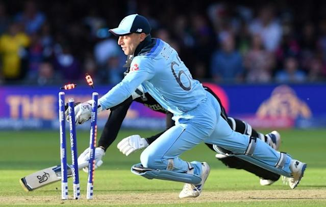 Technical knockout: Jos Buttler runs out Martin Guptill off the last ball of a dramatic Super Over to give England victory (AFP Photo/Paul ELLIS)