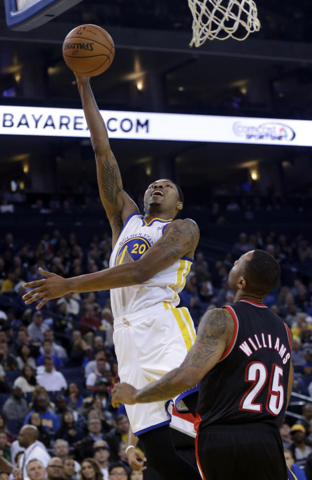 Golden State Warriors' Kent Bazemore (20) shoots over Portland Trail Blazers' Mo Williams (25) during the second half of an NBA preseason basketball game on Thursday, Oct. 24, 2013, in Oakland, Calif. (AP Photo/Marcio Jose Sanchez)