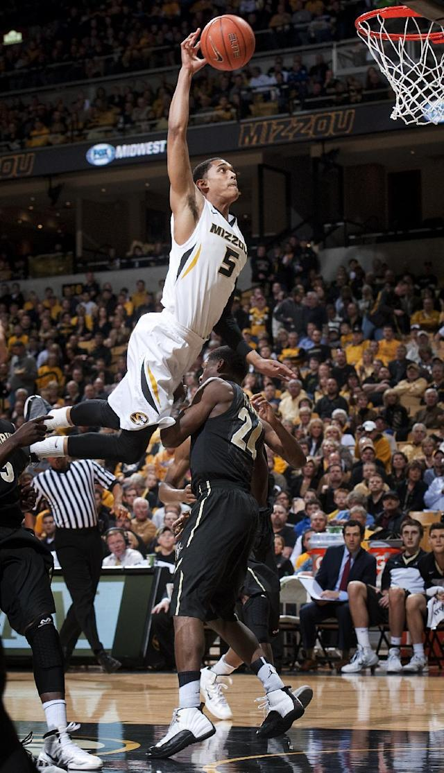 Missouri's Jordan Clarkson, top, tries to dunk over Vanderbilt's Dai-Jon Parker during the first half of an NCAA college basketball game, Wednesday, Feb. 19, 2014, in Columbia, Mo. (AP Photo/L.G. Patterson)
