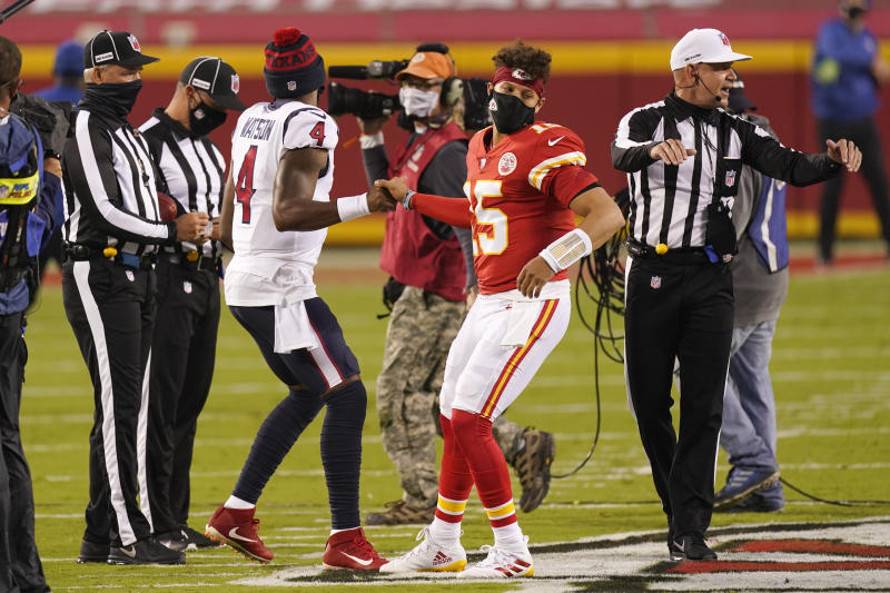Houston Texans quarterback Deshaun Watson (4) and Kansas City Chiefs quarterback Patrick Mahomes (15) meet on the field during the coin toss before the start NFL football game Thursday, Sept. 10, 2020, in Kansas City, Mo. (AP Photo/Charlie Riedel)