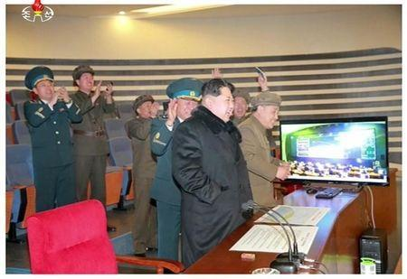 North Korean leader Kim Jong Un reacts as he watches a long range rocket launch in this still image taken from KRT footage and released by Yonhap on February 7, 2016. REUTERS/Yonhap