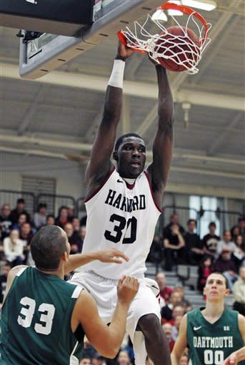 Harvard forward Kyle Casey (30) slams a dunk between Dartmouth forward Jvonte Brooks (33) and guard John Golden, right, in the first half during an NCAA college basketball game in Cambridge, Mass., Saturday, Jan. 7, 2012. (AP Photo/Charles Krupa)