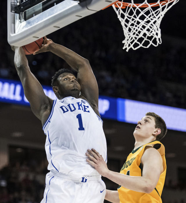Duke forward Zion Williamson (1) goes up for a dunk against North Dakota State forward Rocky Kreuser (34) during the first half of a first-round game in the NCAA mens college basketball tournament Friday, March 22, 2019, in Columbia, S.C. (AP Photo/Sean Rayford)