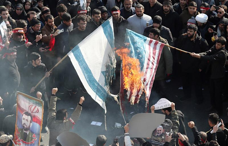 Iranians burn US and Israel flags during a funeral ceremony for slain commander of the Quds Force Qasem Soleimani: EPA
