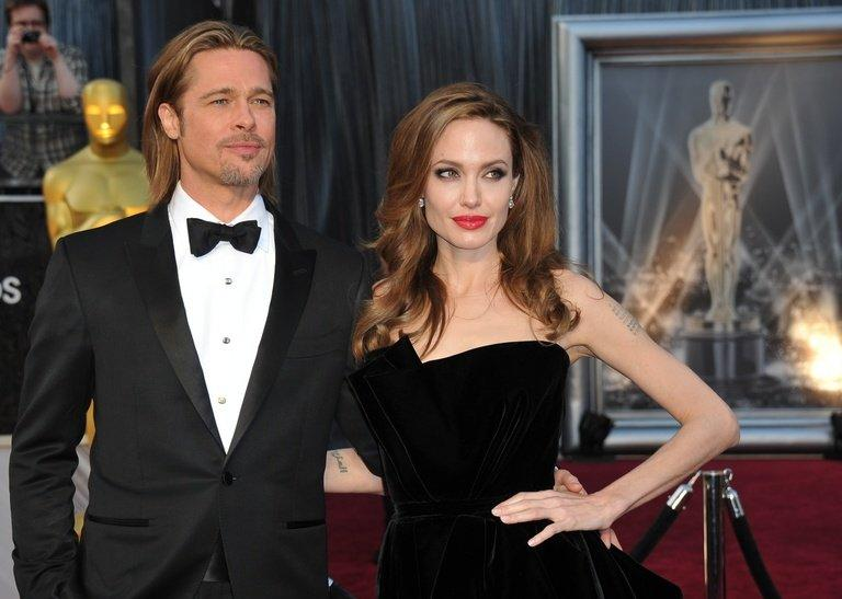 Actress Angelina Jolie and actor Brad Pitt arrive at the Academy Awards on February 26, 2012 in Hollywood, California