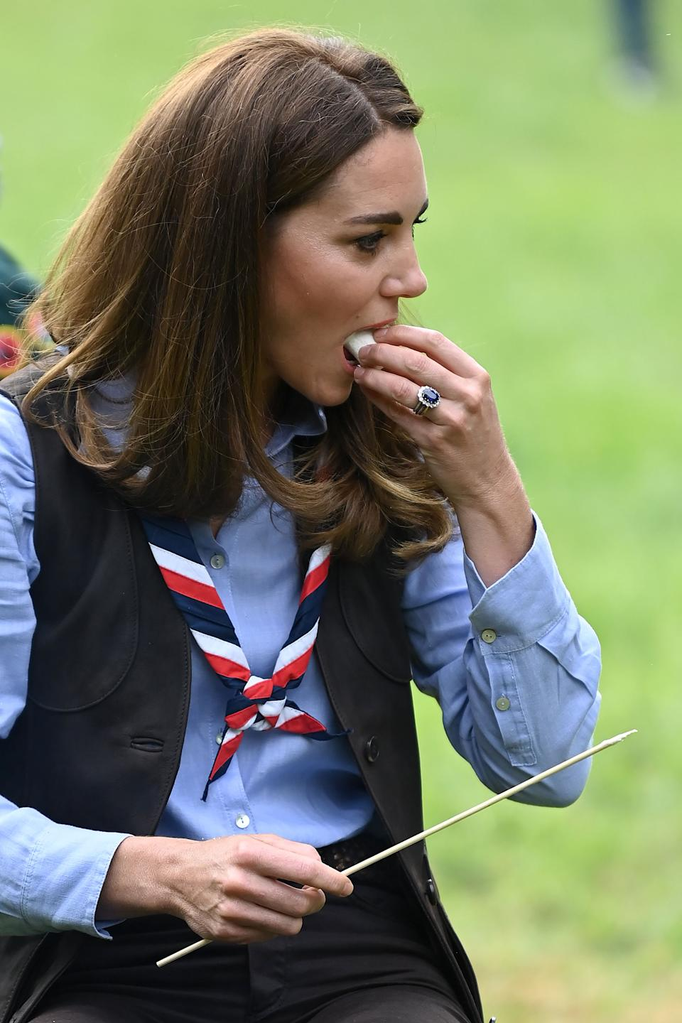 Britain's Catherine, Duchess of Cambridge, toasts marshmallows during her visit to a Scout Group in Northolt, northwest London on September 29, 2020, where she joined Cub and Beaver Scouts in outdoor activities. - The Duchess learned how the Scouts have adapted during the COVID-19 pandemic, and continued Scouting sessions and online activities. (Photo by DANIEL LEAL-OLIVAS / various sources / AFP) (Photo by DANIEL LEAL-OLIVAS/AFP via Getty Images)