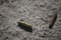 Ammunition casings lay on the ground near the entrance to the house of late Haitian President Jovenel Moise in Port-au-Prince, Haiti, Wednesday, July 7, 2021. Moïse was assassinated in an attack on his private residence early Wednesday, and first lady Martine Moïse was shot in the overnight attack and hospitalized, according to a statement from the country's interim prime minister. (AP Photo/Joseph Odelyn)