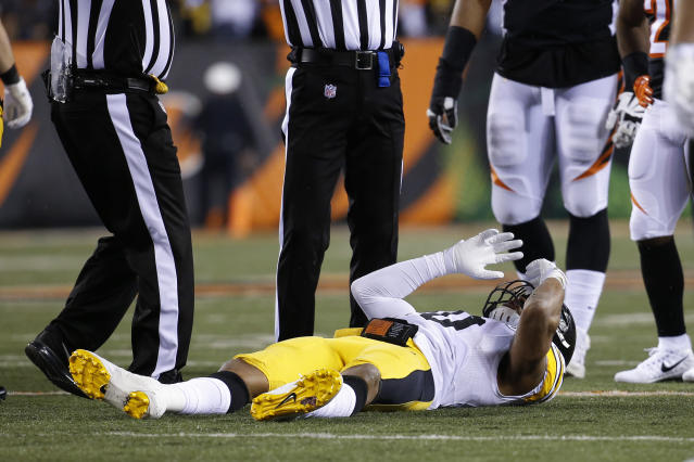 Pittsburgh Steelers inside linebacker Ryan Shazier lies on the field after suffering an injury against the Bengals. (AP)