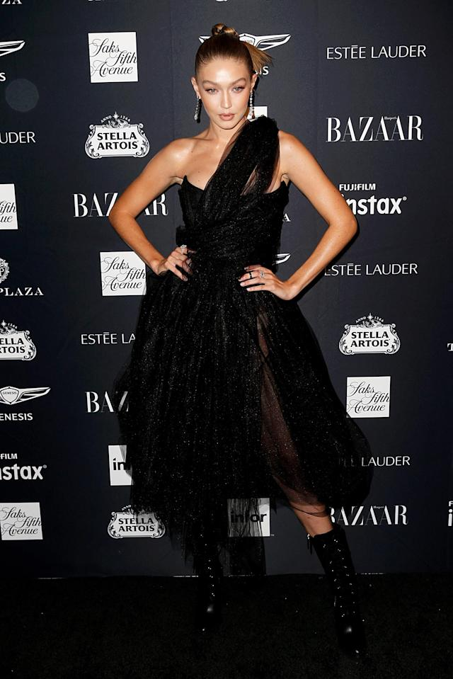 <p>The supermodel paired a tulle dress with knee-high boots. <em>[Photo: Getty]</em> </p>