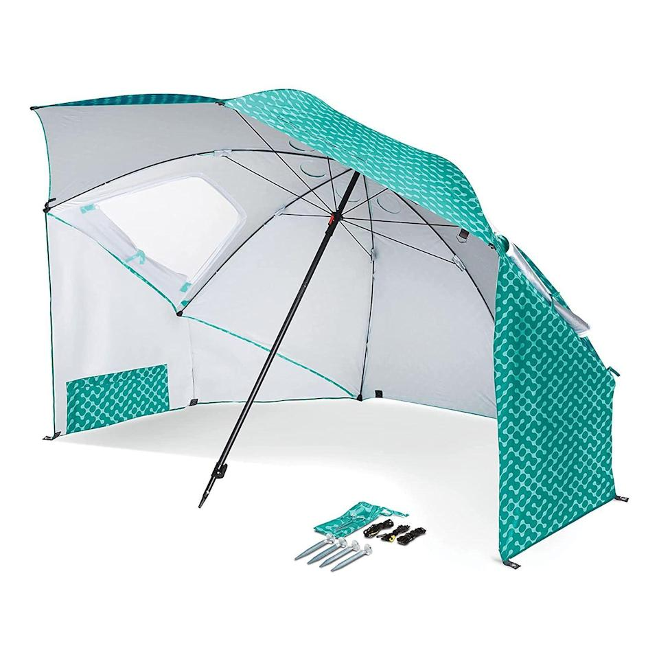 """<p><strong>Sport-Brella</strong></p><p>amazon.com</p><p><strong>$59.99</strong></p><p><a href=""""https://www.amazon.com/dp/B075485WQ7?tag=syn-yahoo-20&ascsubtag=%5Bartid%7C2139.g.36619105%5Bsrc%7Cyahoo-us"""" rel=""""nofollow noopener"""" target=""""_blank"""" data-ylk=""""slk:BUY IT HERE"""" class=""""link rapid-noclick-resp"""">BUY IT HERE</a></p><p>When you can have a beach umbrella that <em>also</em> acts as a pop-up tent, there's no reason you <em>shouldn't</em> have it. Plus, this 8-foot option features windows and comes with stakes and tie-down cords for security. <br></p>"""