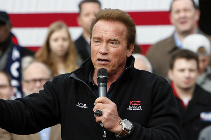 Schwarzenegger introduces Kasich during a rally in Columbus, Ohio, in March. (Photo: Jay LaPrete/AP)