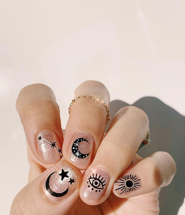 "<p>This design is very much Halloween-esque without being cheesy. If you're into moons, stars, astrology, etc., consider this starry design that'll suit you from your costume party to work on Monday. </p><p><a href=""https://www.instagram.com/p/B9W5la8nOMt/?utm_source=ig_embed&utm_campaign=loading"" rel=""nofollow noopener"" target=""_blank"" data-ylk=""slk:See the original post on Instagram"" class=""link rapid-noclick-resp"">See the original post on Instagram</a></p>"