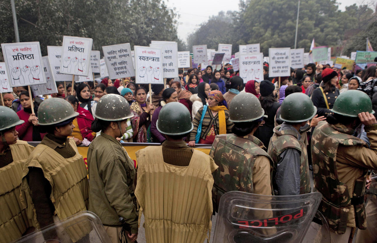 Indian paramilitary women stand guard during a march to mourn the death of a gang rape victim in New Delhi, India, Wednesday, Jan. 2, 2013. India's top court says it will decide whether to suspend lawmakers facing sexual assault charges as thousands of women gathered at the memorial to independence leader Mohandas K. Gandhi to demand stronger protection for their safety. (AP Photo/ Dar Yasin)