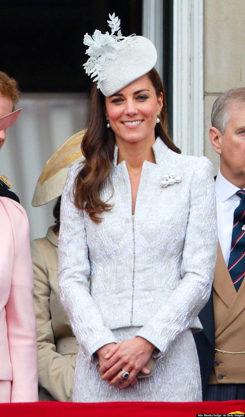 The Duchess stepped out in an ice blue brocade Alexander McQueen skirt suit for the annual Trooping the Colour Ceremony on June 14, 2014.