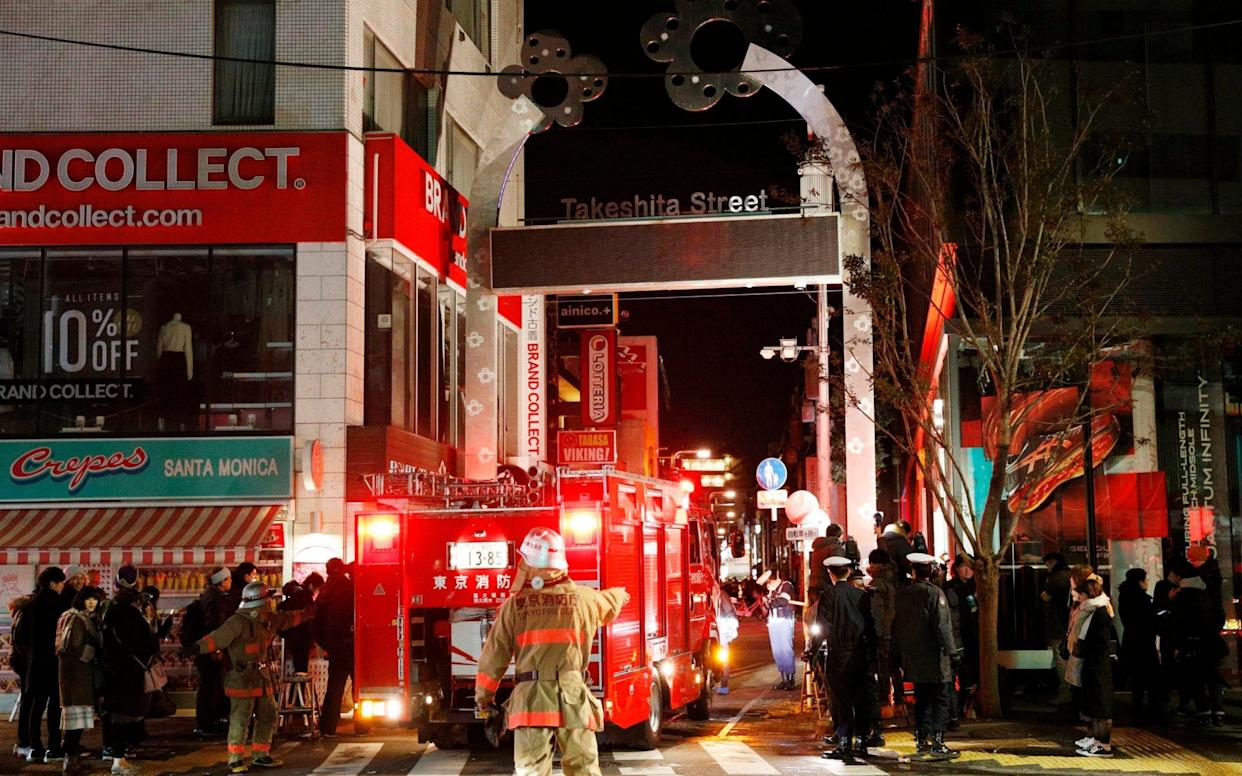 Police and firefighters inspect around the site of a car attack near Takeshita Street in Tokyo, - Kyodo News