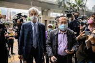 Former lawmakers Martin Lee (L) and Albert Ho arrive at West Kowloon court in Hong Kong to receive sentencing after being found guilty of organising an unauthorised assembly in 2019