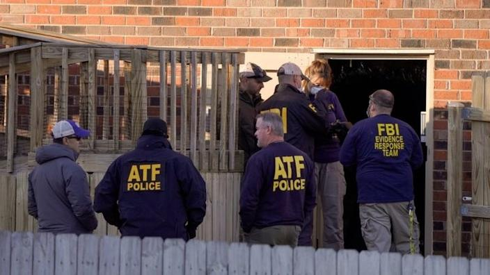 Law enforcement officers search the property of a possible person of interest in Antioch, near Nashville. Photo: 26 December 2020