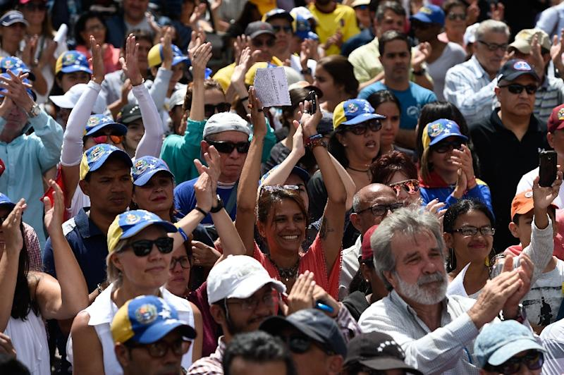 "Venezuelan opposition supporters gather to listen to the head of Venezuela's National Assembly and the country's self-proclaimed ""acting president"" Juan Guaido, during a rally in Caracas (AFP Photo/Federico PARRA)"