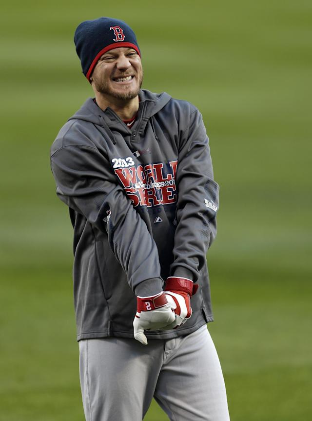 Boston Red Sox pitcher Jake Peavy stretches during baseball practice on Friday, Oct. 25, 2013, in St. Louis. Peavy is slated to start when the Red Sox play the St. Louis Cardinals in Game 3 of the World Series scheduled for Saturday in St. Louis. (AP Photo/Jeff Roberson)
