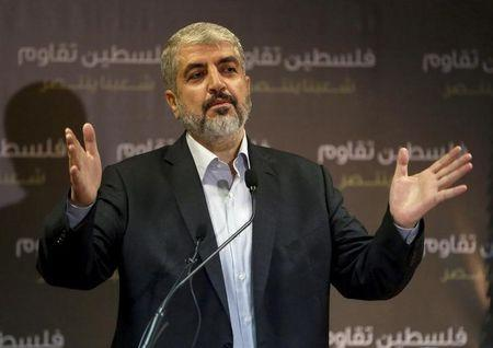 Hamas leader Meshaal talks during a news conference in Doha