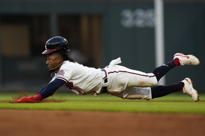 Atlanta Braves' Ozzie Albies steals second base in the first inning of a baseball game against the San Francisco Giants, Saturday, Aug. 28, 2021, in Atlanta. (AP Photo/John Bazemore)