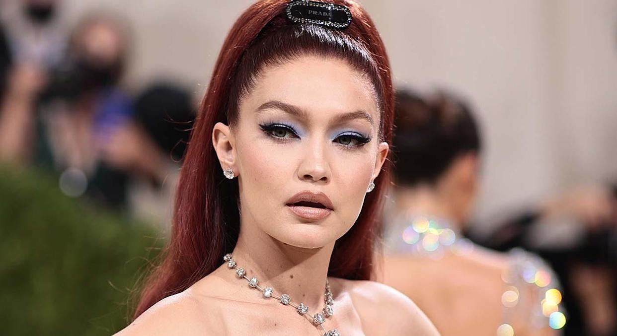 Gigi Hadid opts for Prada dress and accessories, Chopard jewellery, but Maybelline concealer for the 2021 Met Gala.  (Getty Images)