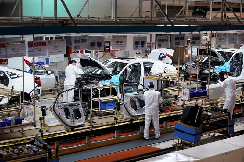 Employees work on a production line inside a Dongfeng Honda factory in Wuhan