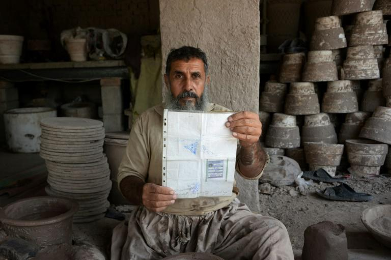 Bloody violence threatens this weekend's parliamentary election in Afghanistan, but potter Shirin Agha, 45, says he is determined to cast his ballot