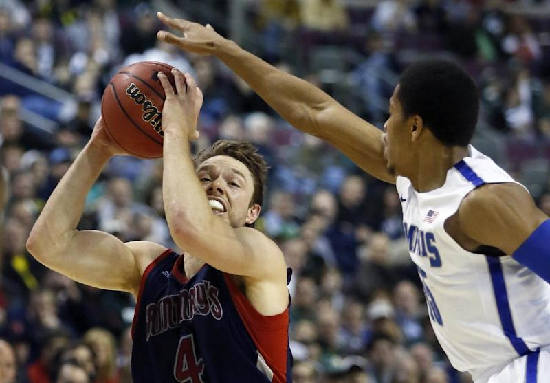 Saint Mary's guard Matthew Dellavedova (4) is guarded by Memphis guard Geron Johnson in the first half of a second-round game of the NCAA college basketball tournament Thursday, March 21, 2013, in Auburn Hills, Mich. (AP Photo/Duane Burleson)