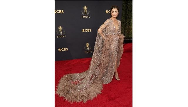 Keri Russell dressed all the way up in a Zuhair Murad couture gown in rose mauve with feathers surrounding the hem of a caped back (AP photo)