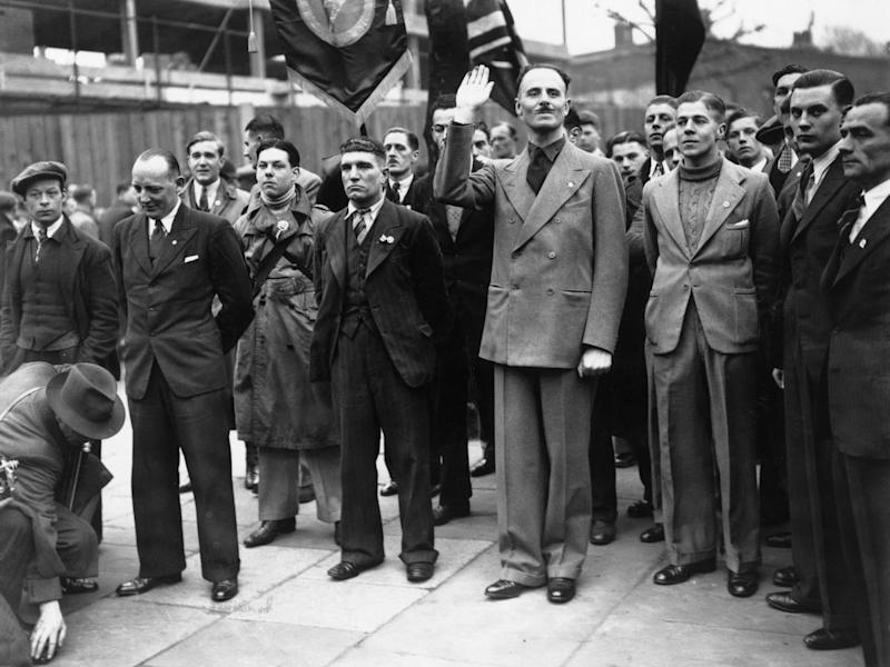 British Union of Fascists leader Oswald Mosley salutes supporters during a march in Bermondsey, London: Getty Images