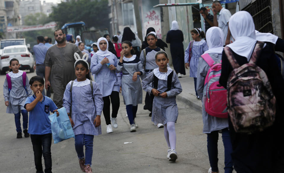 Students walk to the United-Nation run Elementary School on the first day of the new school year at the Shati refugee camp in Gaza City, Saturday, Aug. 8, 2020. Schools run by both Palestinian government and the U.N. Refugee and Works Agency (UNRWA) have opened almost normally in the Gaza Strip after five months in which no cases of community transmission of the coronavirus had been recorded. (AP Photo/Adel Hana)