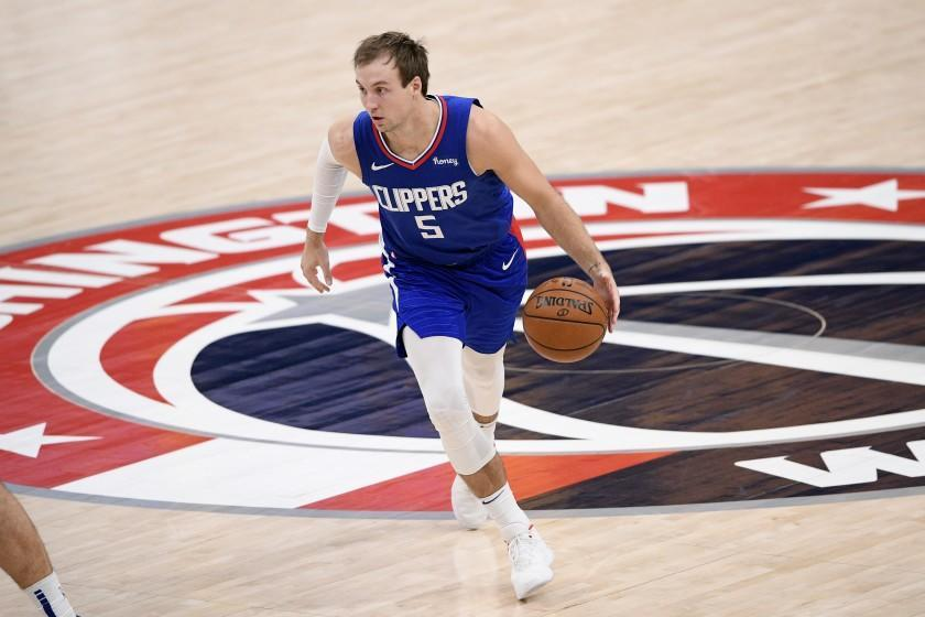 Los Angeles Clippers guard Luke Kennard (5) dribbles the ball during the second half of an NBA basketball.