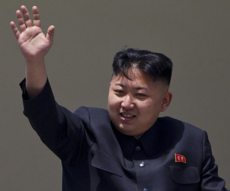 FILE - In this Sunday, April 15, 2012 file photo, North Korean leader Kim Jong Un waves from a balcony at the end of a mass military parade in Pyongyang's Kim Il Sung Square. China has shown a  growing frustration with longtime ally North Korea and talk of a North Korean collapse is no longer a taboo subject it once was. There is no sign that the North Korean regime is in danger or that U.S. President Barack Obama and Chinese President Xi Jinping will discuss that possibility when they meet starting Friday June 7, 2013 in California.  (AP Photo/David Guttenfelder, File)