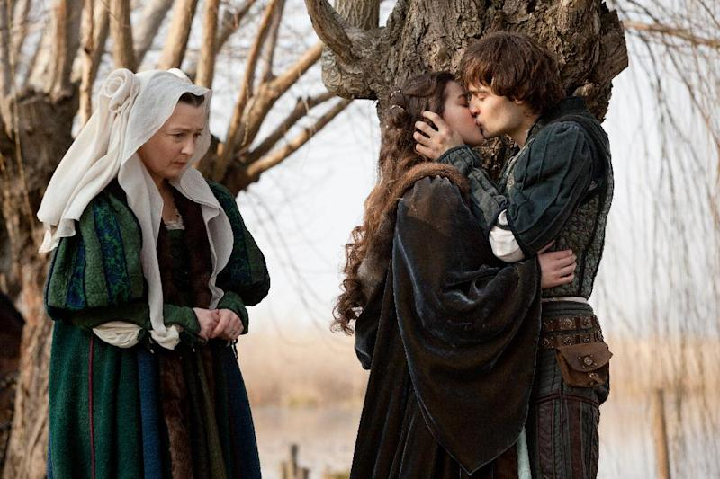 "This image released by Relativity Media shows Douglas Booth, right, and Hailee Steinfeld, center, in a scene from ""Romeo and Juliet."" (AP Photo/Relativity Media, Philippe Antonello)"