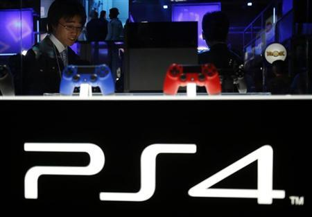 Visitor looks at Sony Corp's new PlayStation 4 game console at the Tokyo Game Show in Chiba