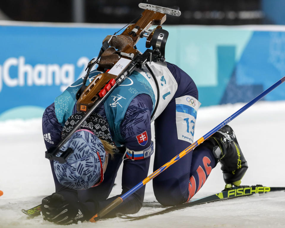 <p>Anastasiya Kuzmina, of Slovakia, collapse in the finish area after winning the silver medal in the women's 10-kilometer biathlon pursuit at the 2018 Winter Olympics in Pyeongchang, South Korea, Monday, Feb. 12, 2018. (AP Photo/Andrew Medichini) </p>