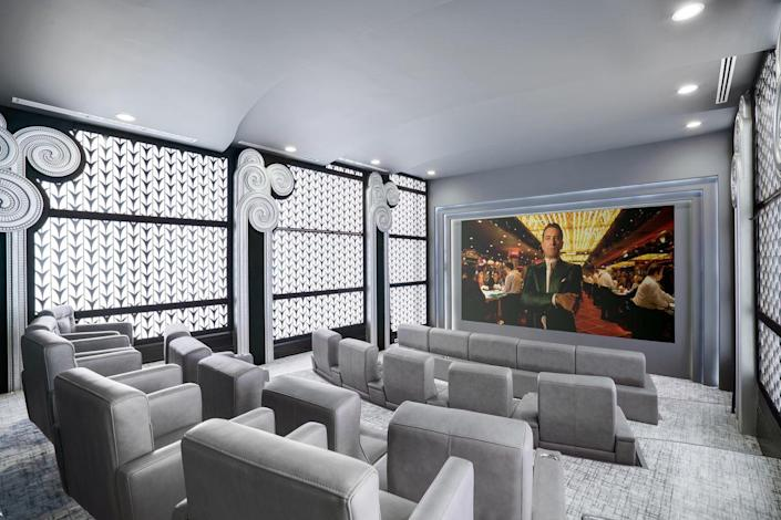 A cinema-style theater room will save you a trip to the movies.