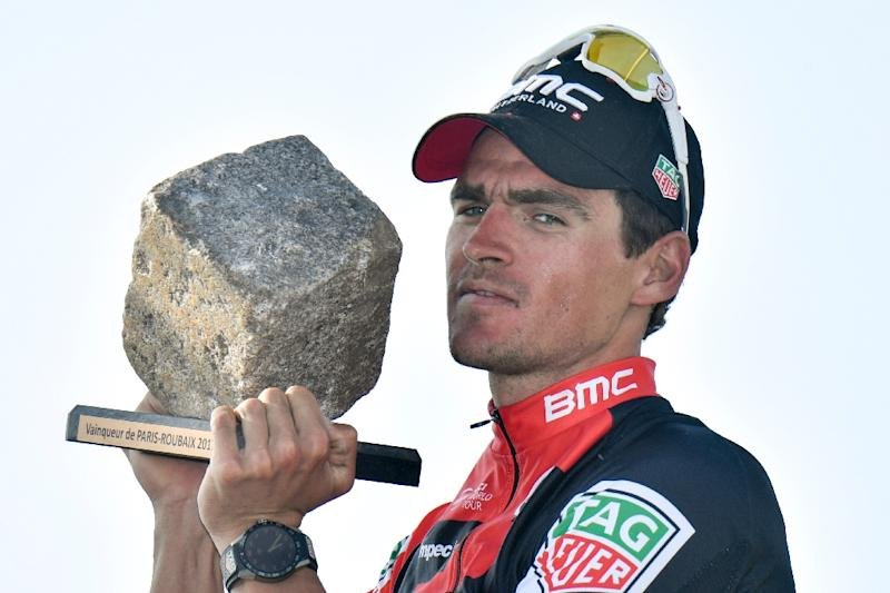 Belgium  39 s Greg Van Avermaet holds his trophy as he celebrates on the 853d4d24e