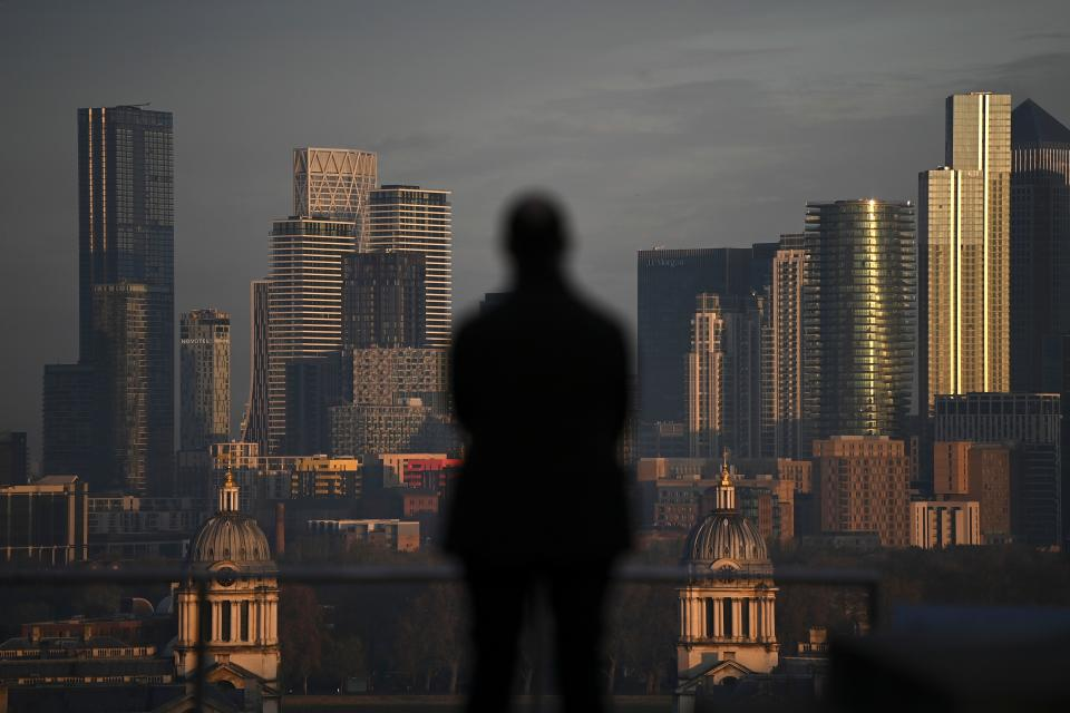 The morning sunlight illuminates the office buildings of the Canary Wharf financial district in London on November 9, 2020. - Britain and the European Union resumed crucial negotiations in London on Monday over a post-Brexit free trade deal, with time running short and both sides saying major obstacles remain. (Photo by DANIEL LEAL-OLIVAS / AFP) (Photo by DANIEL LEAL-OLIVAS/AFP via Getty Images)
