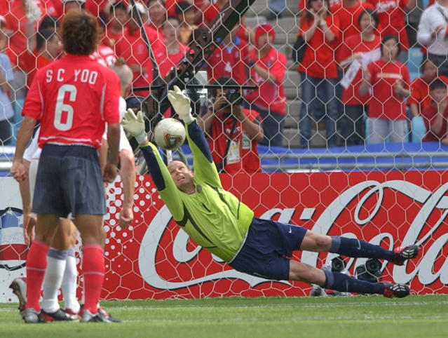 FILE - In this June 10, 2002, file photo, USA's goalkeeper Brad Friedel stops a freekick during a 2002 World Cup soccer match against South Korea at the Daegu World Cup Stadium in Daegu, South Korea. Brad Friedel, Carlos Bocanegra and Thierry Henry are among first-year eligible nominated for the National Soccer Hall of Fames class of 2018. (AP Photo/David Longstreath, File)