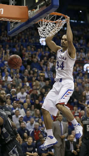 Kansas' Perry Ellis dunks the ball during the first half of an NCAA college basketball game against Georgetown Saturday, Dec. 21, 2013, in Lawrence, Kan. (AP Photo/Charlie Riedel)