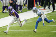 Minnesota Vikings wide receiver Justin Jefferson (18) catches a pass in front of Detroit Lions cornerback Amani Oruwariye, right, during the second half of an NFL football game, Sunday, Nov. 8, 2020, in Minneapolis. (AP Photo/Jim Mone)
